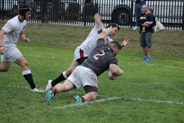 First Team All Ivy Selection, Brown University Hooker John Landers scores authoritatively against Harvard.