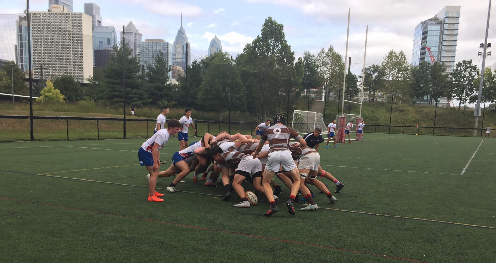 Rugby scrum Brown v Penn with the Philly skyline in the background
