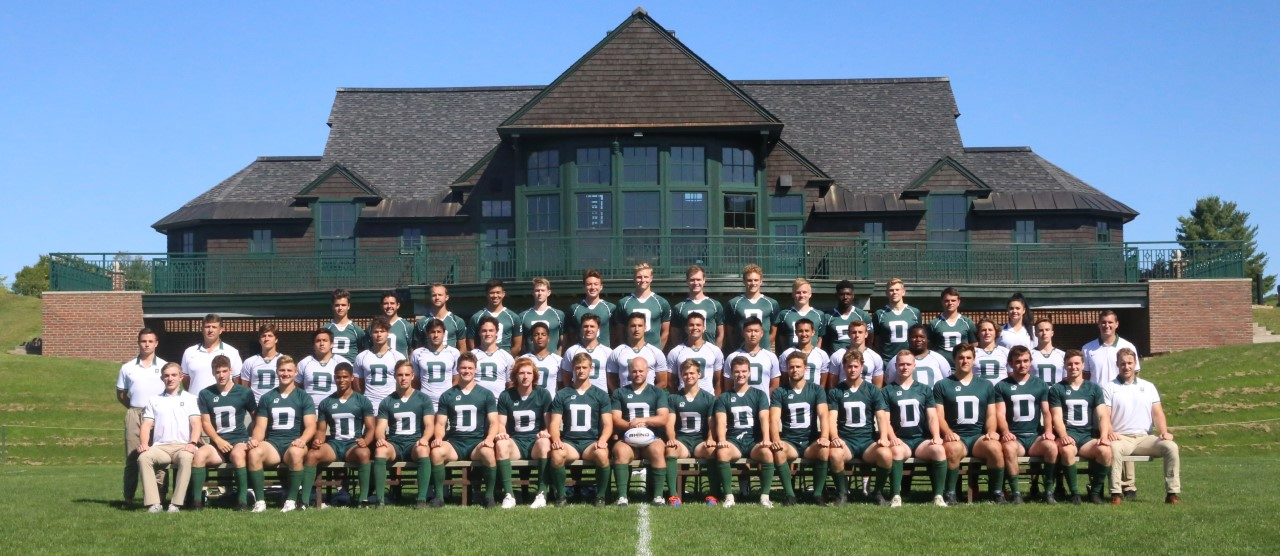 Dartmouth men's rugby team posing on the field