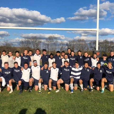 Yale Men team photo on a rugby field