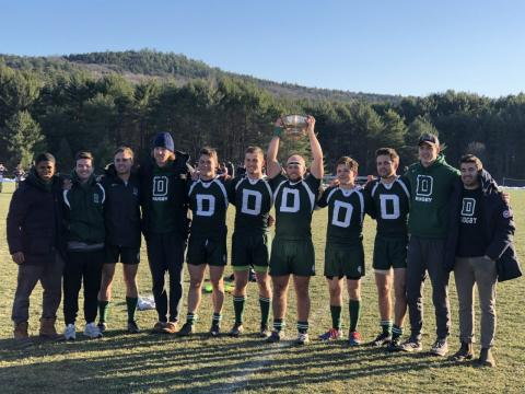 Dartmouth Men posing for a team photo with their trophy