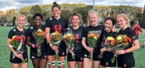 Harvard seniors celebrate after home win