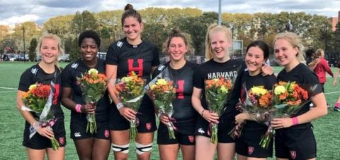 Harvard seniors celebrate after home win