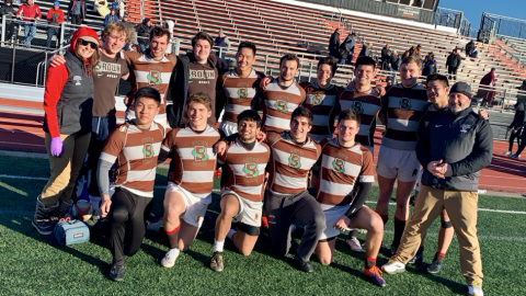 Brown Men's team posing on the field at William Patterson