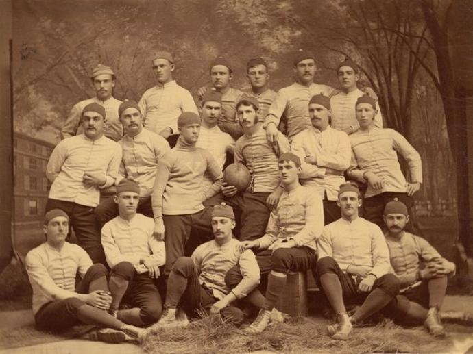 The 1879 Yale rugby team, with team captain Walter Camp (center, holding football).