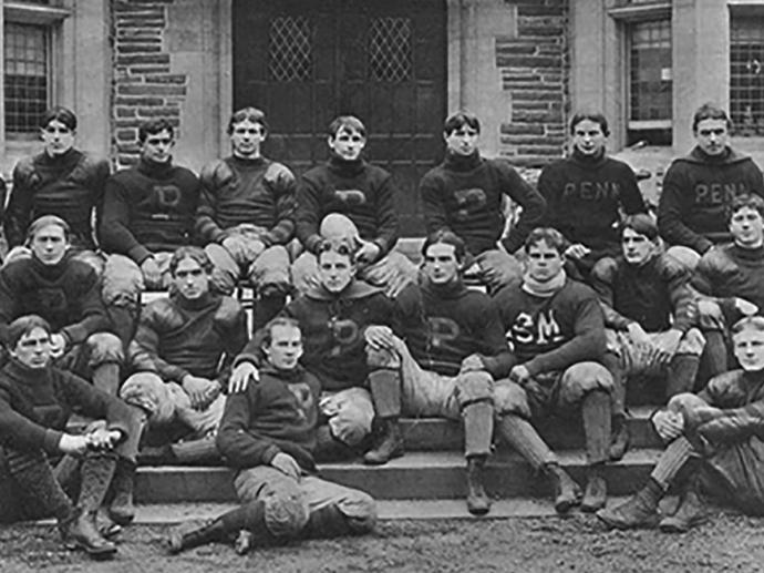 the undefeated Penn Rugby Football team was photographed in front of Houston Hall