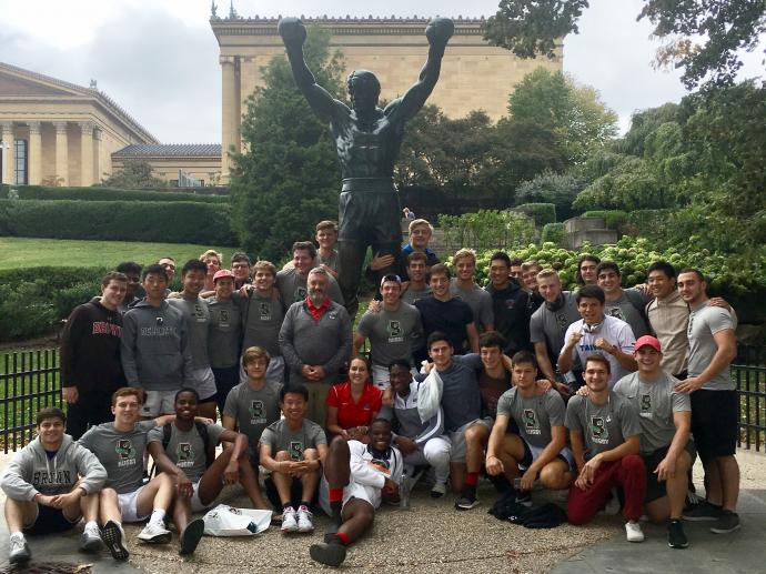 Brown Rugby in front of the rocky statue in Philly