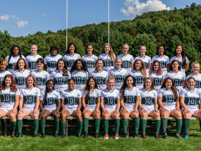 Dartmouth Women's rugby team posing on the field
